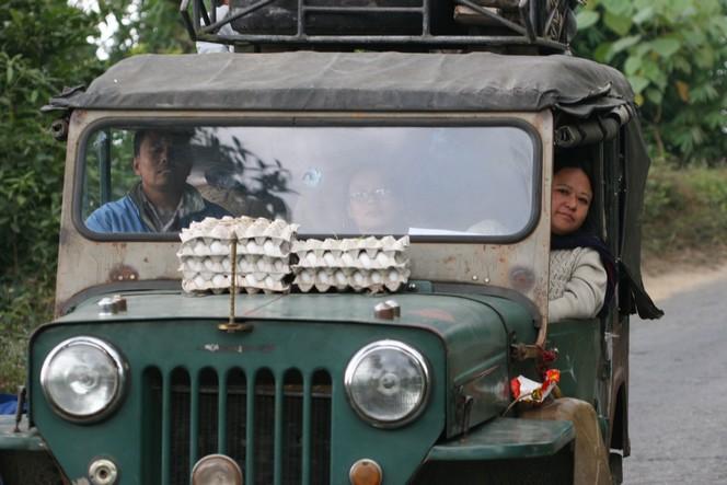Carton of eggs on the bonnet of a Jeep in Darjeeling