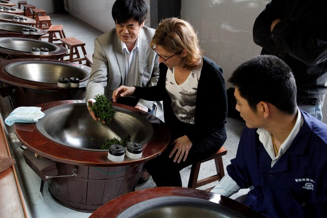 Carine Baudry helping in the making of a Long Jing