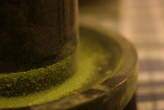Matcha is crushed in a stone mill